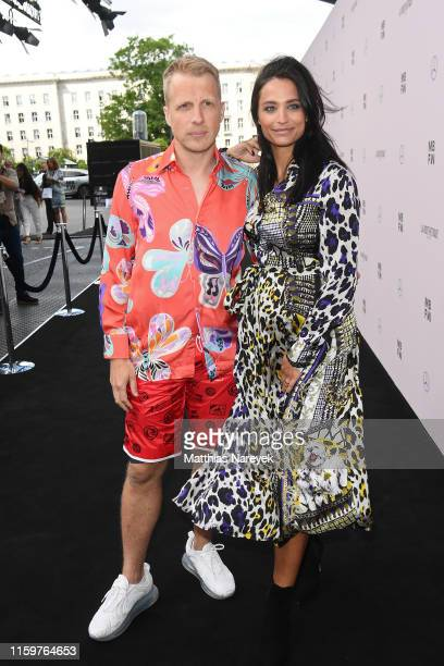 Oliver Pocher and Amira Aly attend the Sportalm Kitzbuehel show during the Berlin Fashion Week Spring/Summer 2020 at ewerk on July 03 2019 in Berlin...