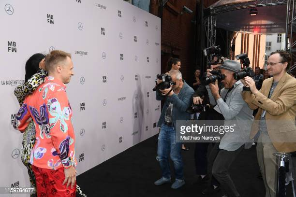 Oliver Pocher and Amira Aly attend the Sportalm Kitzbuehel show during the Berlin Fashion Week Spring/Summer 2020 at ewerk on July 03, 2019 in...