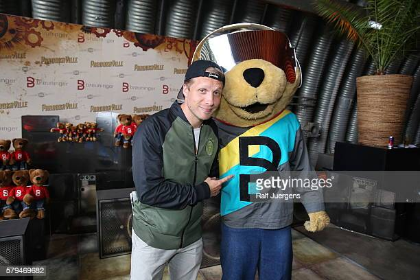 Oliver Pocher and BreuniBaer mascot of Breuninger pose for a photograph at the ParookaVille Festival on July 15 2016 in Weeze Germany