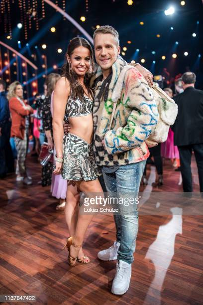 Oliver Pocher and Christina Luft pose on stage after the 1st show of the 12th season of the television competition 'Let's Dance' on March 22 2019 in...