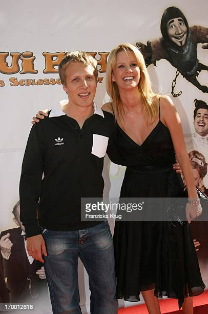 Oliver Pocher and girlfriend Monica Ivancan At The Premiere Of 'Hui Buh The Goofy Ghost' At The Mathäser movie palace in Munich 160706