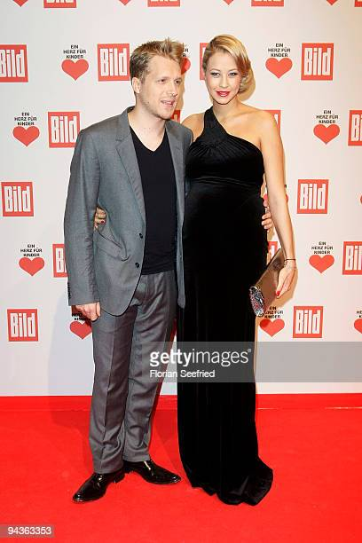 Oliver Pocher and girlfriend Sandy MeyerWoelden attend the 'Ein Herz fuer Kinder' Gala at Studio 20 at Adlershof on December 12 2009 in Berlin Germany