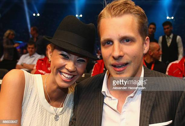 Oliver Pocher and his girl friend Sandy Meyer-Woelden attend the WBO, IBF & IBO Heavyweight title fight at Veltins Arena on June 20, 2009 in...