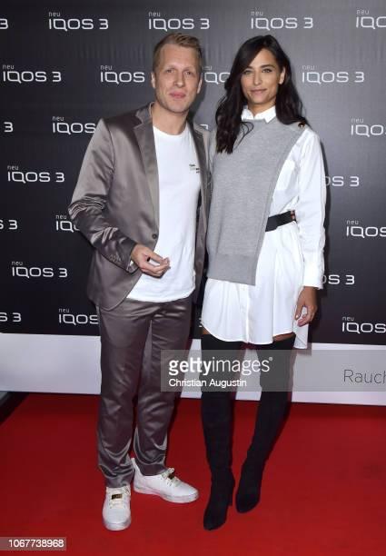 Oliver Pocher and his girlfriend Amira Aly attend the German premiere of IQOS 3 at Museum fuer Hamburgische Geschichte on November 14 2018 in Hamburg...