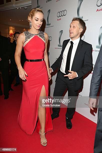 Oliver Pocher and his girlfriend Sabine Lisicki the Audi Generation Award 2015 at Hotel Bayerischer Hof on December 2 2015 in Munich Germany