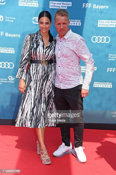 Oliver Pocher and his pregnant girlfriend Amira Aly attend the Kroos world premiere on June 30 2019 in Cologne Germany