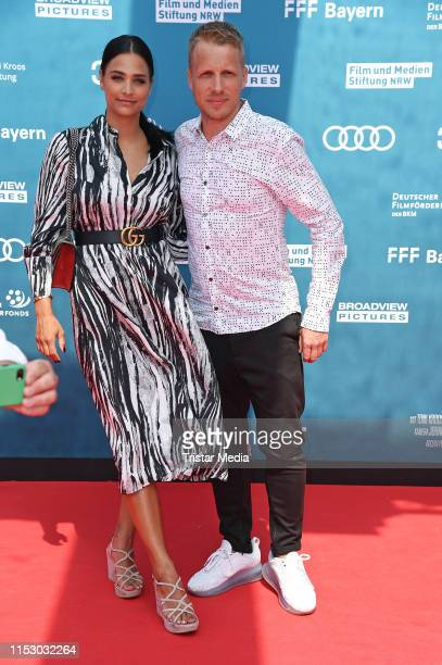 "Oliver Pocher and his pregnant girlfriend Amira Aly attend the ""Kroos"" world premiere on June 30, 2019 in Cologne, Germany."
