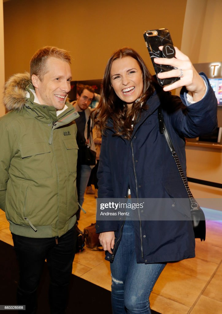 Oliver Pocher and Laura Wontorra attends the exclusive preview of 'Zwischen zwei Leben - The Mountain between us' at Filmpalast Cologne on November 30, 2017 in Cologne, Germany. Jack Wolfskin presents its capsule collection based on the movie in collaboration with 20th Century Fox.