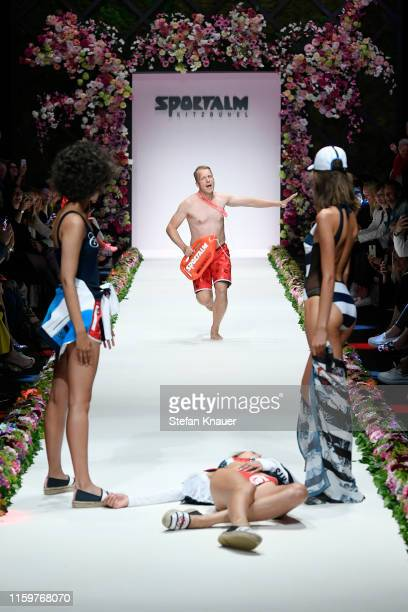 Oliver Pocher and models perform on the runway at the Sportalm Kitzbuehel show during the Berlin Fashion Week Spring/Summer 2020 at ewerk on July 03...