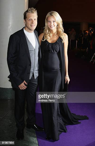 Oliver Pocher and Sandy Meyer Woelden attend the Mc Donalds Fundraising Gala at Hyatt Hotel on October 17 2009 in Berlin Germany