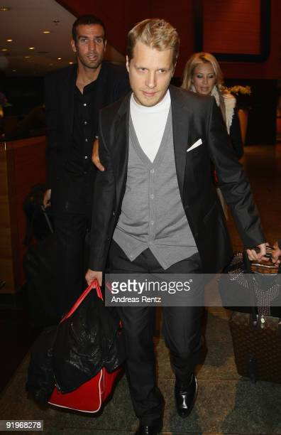 Oliver Pocher and Sandy Meyer Woelden leave the Hotel during the Mc Donalds Fundraising Gala at Hyatt Hotel on October 17 2009 in Berlin Germany