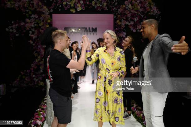 Oliver Pocher and Ulli Ehrlich high five on the runway ahead of the Sportalm Kitzbuehel show during the Berlin Fashion Week Spring/Summer 2020 at...