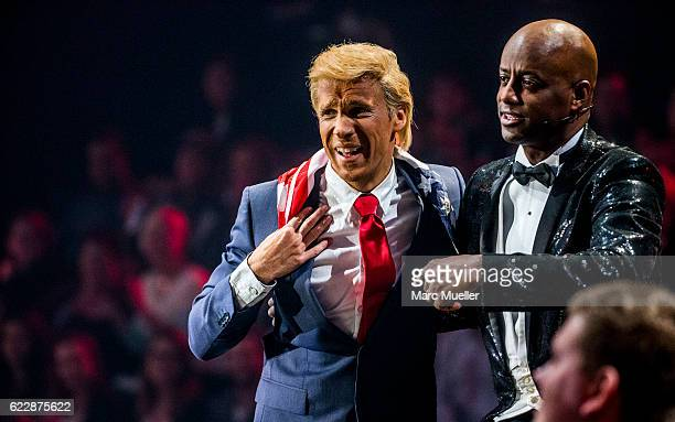 Oliver Pocher, dressed as Donald Trump, and Yared Dibaba are seen during the first live show of 'Deutschland tanzt' on November 12, 2016 in Munich,...