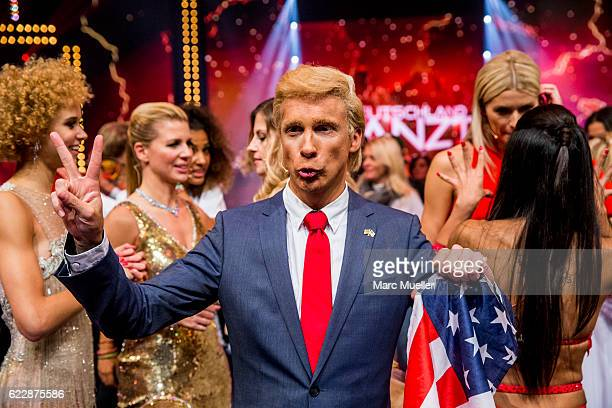 Oliver Pocher dressed as Donald Trump performs during the first live show of 'Deutschland tanzt' on November 12 2016 in Munich Germany In the first...