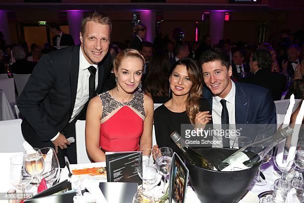 Oliver Pocher his girlfriend Sabine Lisicki and Robert Lewandowski with his wife Anna attend the Audi Generation Award 2015 at Hotel Bayerischer Hof...