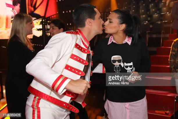 Oliver Pocher kisses Amira Aly during the 5th show of the 12th season of the television competition Let's Dance on April 26 2019 in Cologne Germany