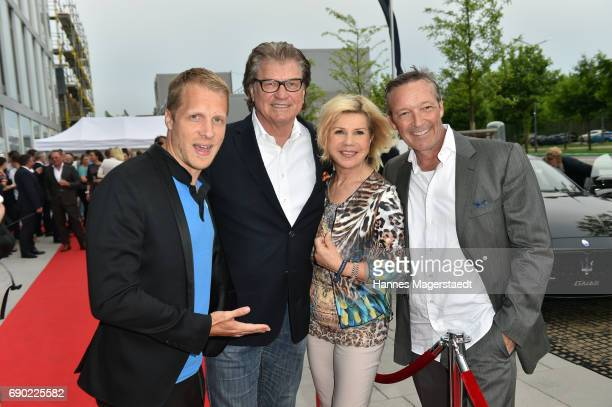 Oliver Pocher Michael Hartl Marianne Hartl and Michael Roll during the Maserati Showroom Opening on May 30 2017 in Munich Germany