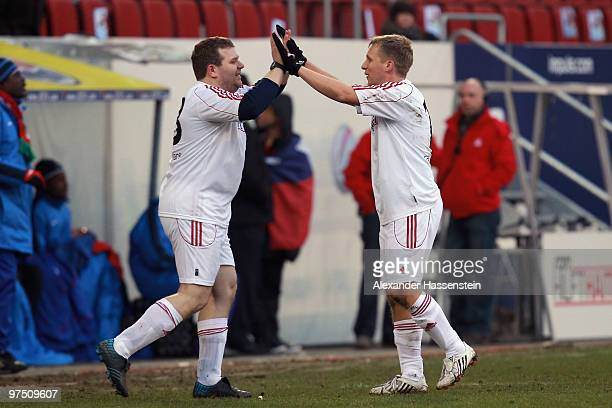 Oliver Pocher of the ran AllstarTeam celebrates with his team mate Elton during the charity match for earthquake victims in Haiti between ran Allstar...