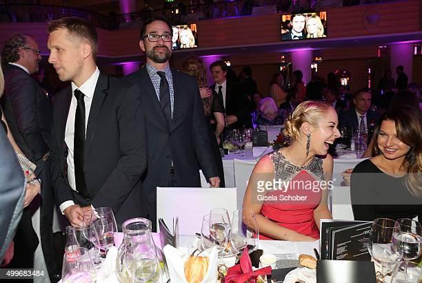 Oliver Pocher Sabine Lisicki Anna Lewandowski chat during the Audi Generation Award 2015 at Hotel Bayerischer Hof on December 2 2015 in Munich Germany