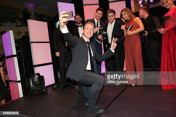 Oliver Pocher shoots a selfie with Robert Lewandowski Florian Mundt and Gizem Emre during the Audi Generation Award 2015 at Hotel Bayerischer Hof on...