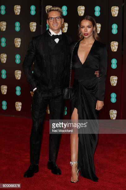 Oliver Proudlock and Emma Louise Connolly arrive at the EE British Academy Film Awards at the Royal Albert Hall on February 18 2018 in London England