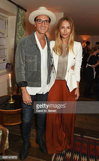 Oliver Proudlock and Emma Louise Connolly attend a private dinner hosted by Dylan Jones and JeanDavid Malat to celebrate artist Mike Dargas at Soho...