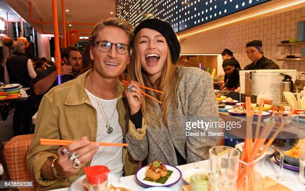 Oliver Proudlock and Emma Louise Connolly attend opening of new YO sushi site on Tottenham Court Road as the brand celebrates its 20th anniversary on...
