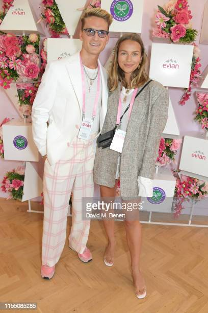 Oliver Proudlock and Emma Louise Connolly attend the evian Live Young suite at The Championships, Wimbledon 2019 on July 11, 2019 in London, England.