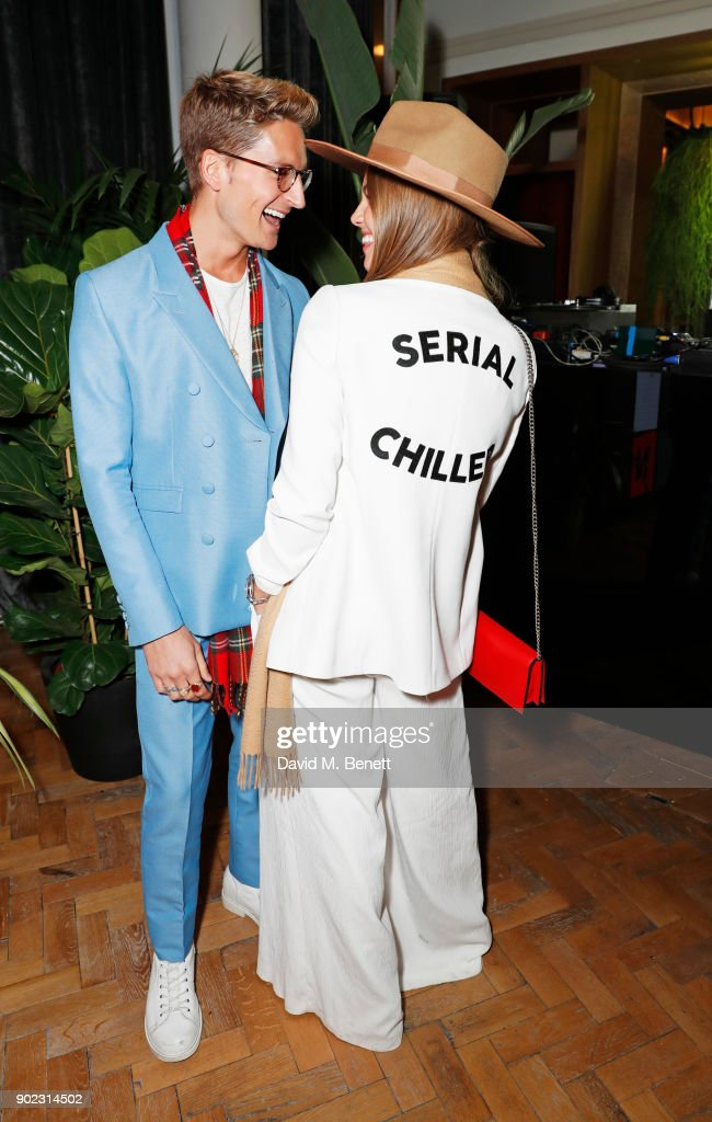Oliver Proudlock (L) and Emma Louise Connolly attend the Topman LFWM party at Mortimer House on January 7, 2018 in London, England.