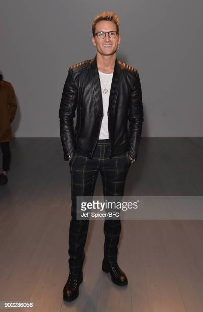 Oliver Proudlock poses on the front row at the Christopher Raeburn show during London Fashion Week Men's January 2018 at BFC Show Space on January 7...