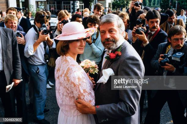 Oliver Reed actor marries Josephine Burge at Epsom Surrey England on September 7 1985