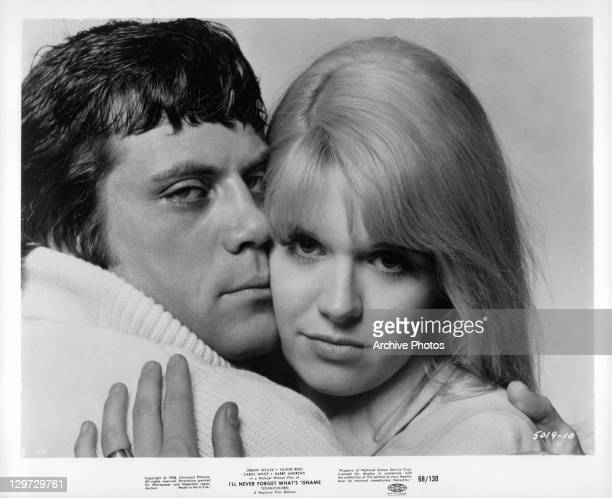 Oliver Reed holding Carol White in a scene from the film 'I'll Never Forget What's 'Isname' 1967