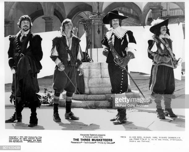 Oliver Reed Michael York Richard Chamberlain and Frank Finlay in a scene from the movie The Three Musketeers circa 1974