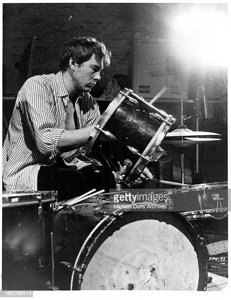 Oliver Reed sets up the drums in a scene from the film 'The Party's Over' 1965 Photo by Allied Artists/Getty Images