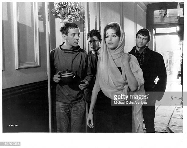 Oliver Reed walks with Louise Sorel in a scene from the film 'The Party's Over' 1965 Photo by Allied Artists/Getty Images