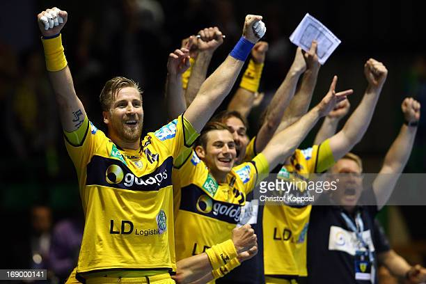 Oliver Roggisch and Uwe Gensheimer of RheinNeckar Loewen celebrate the victory after the EHF Cup Semi Final match between Frisch Auf Goeppingen and...