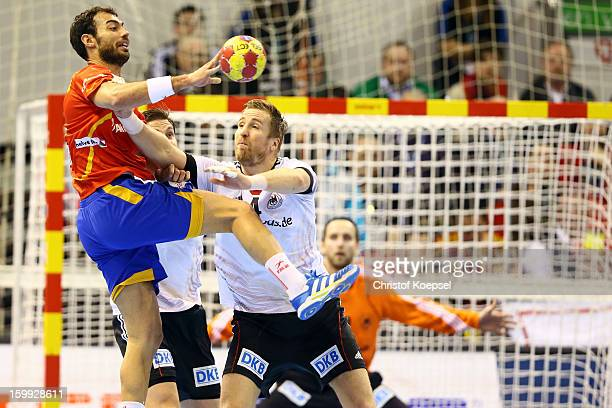 Oliver Roggisch of Germany defends against Daniel Melian of Spain during the quarterfinal match between Spain and Germany at Pabellon Principe Felipe...