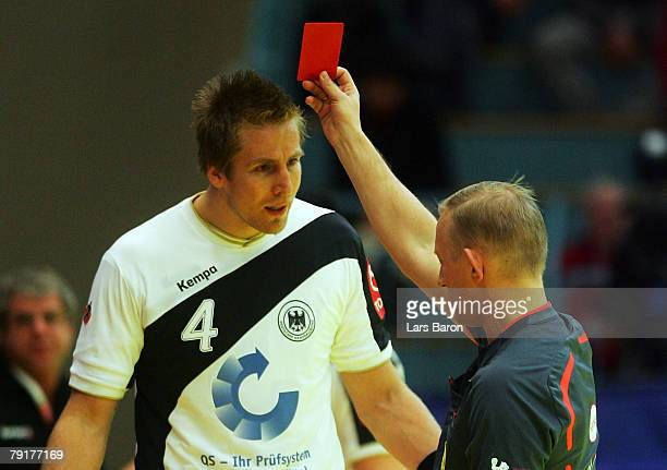 Oliver Roggisch of Germany is shown the red card during the Men's Handball European Championship main round Group II match between Germany and France...