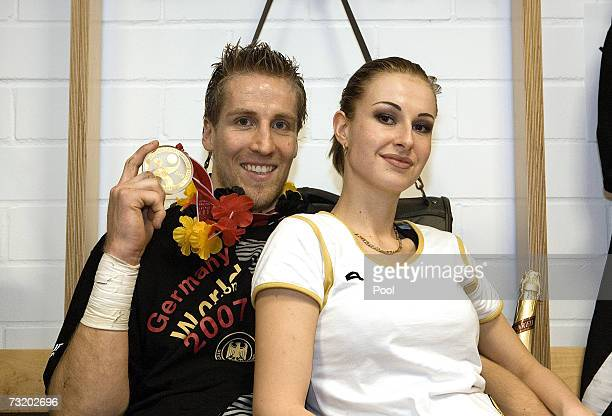 Oliver Roggisch poses with a friend at the locker rooms after the Mens World Championship Final game between Germany and Poland at the Cologne Arena...