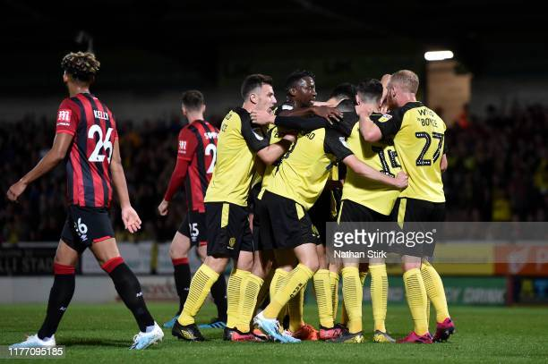 Oliver Sarkic of Burton Albion celebrates with teammates after scoring his team's first goal during the Carabao Cup Third Round match between Burton...