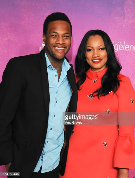 Oliver Saunders and Garcelle Beauvais attend Fonkoze's Hot Night In Haiti Los Angeles Event on November 11 2017 in Los Angeles California