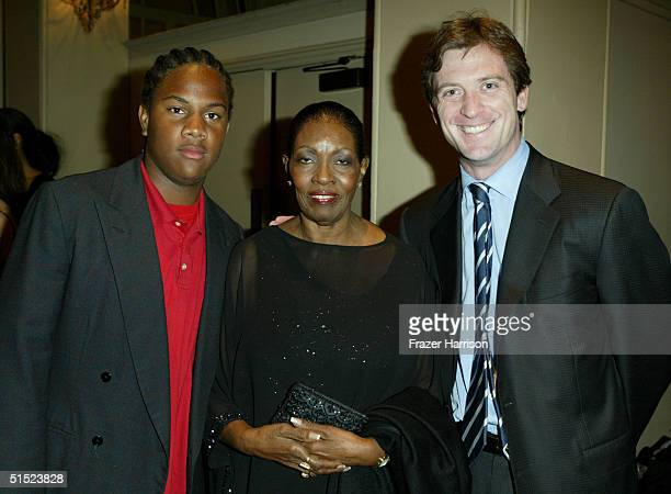 Oliver Saunders, Marie Claire Beauvais and Mike Nilon, husbad to honoree Garcelle Beauvais-Nilon are seen at the Optimist Youth Homes & Family...