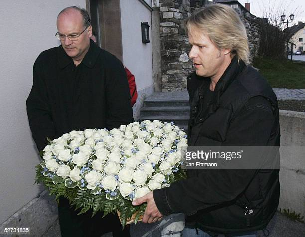 Oliver Schell the son of actress Maria Schell carries flowers to his mothers coffin at the Nikolaus church on April 29 2005 in Preitenegg Austria