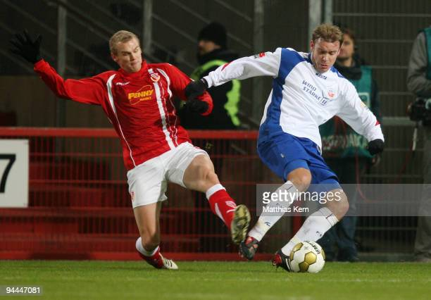 Oliver Schroeder of Rostock battles for the ball with Sascha Dum of Cottbus during the Second Bundesliga match between FC Energie Cottbus and FC...