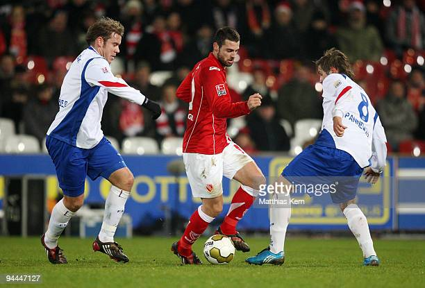 Oliver Schroeder Stiven Rivic and Kevin Pannewitz battle for the ball during the Second Bundesliga match between FC Energie Cottbus and FC Hansa...