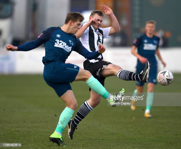 Oliver Shenton of Chorley FC and Joseph Bateman of Derby County battle for the ball during the FA Cup Third Round match between Chorley and Derby...