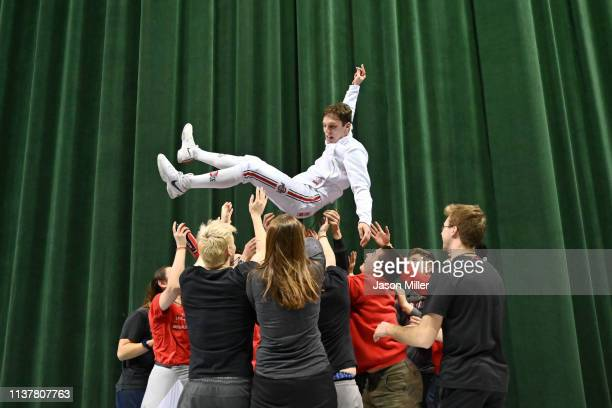 Oliver Shindler of Ohio State celebrates with teammates and fans during the Division I Men's Fencing Championship held at The Wolstein Center on the...