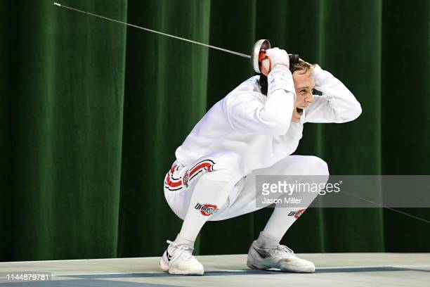 Oliver Shindler of the Ohio State Buckeyes celebrates after defeating Teddy Lombardo of the Columbia Lions during the Division I Men's Fencing...