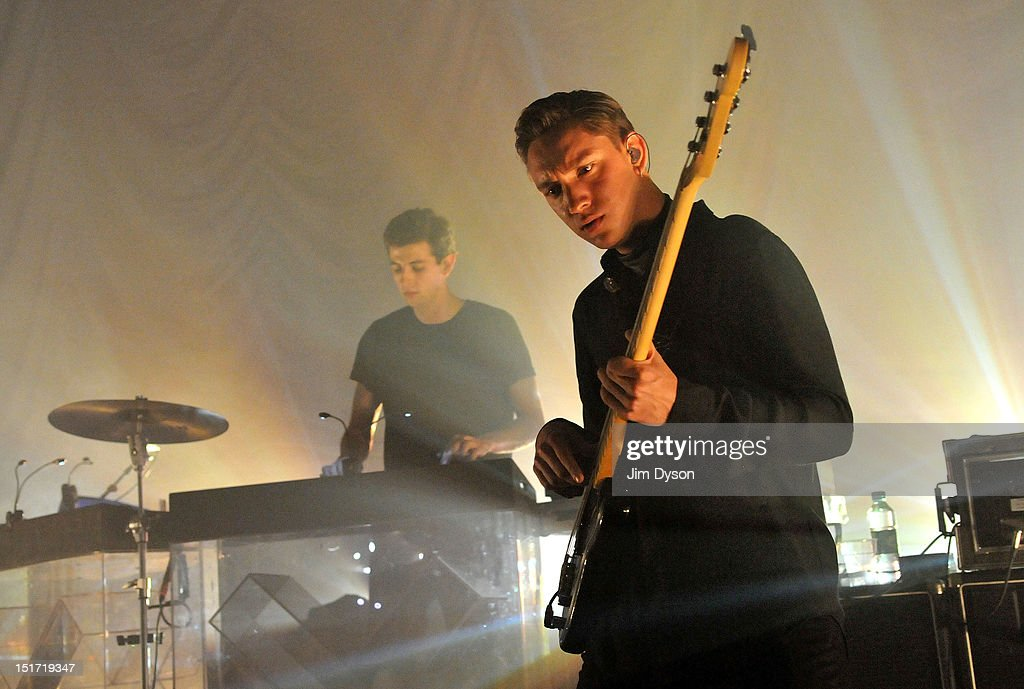 Oliver Sim (R) and Jamie Smith of The XX perform live on stage at Shepherds Bush Empire to support the release of their second album, Coexist, on September 10, 2012 in London, United Kingdom.