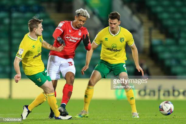 Oliver Skipp and Christophe Zimmermann of Norwich City and Tobias Figueiredo of Nottingham Forest compete for the ball during the Sky Bet...
